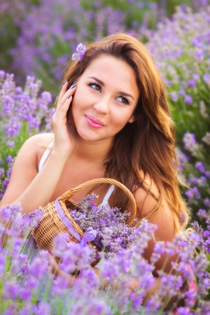 Beautiful girl with long hair on lavender field Standard-Bild