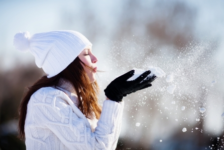 Girl playing with snow in park Standard-Bild