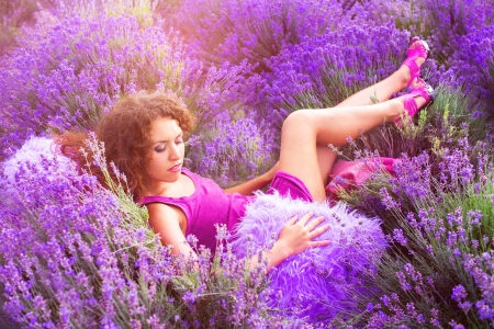 Beautiful young woman sleeping in lavender