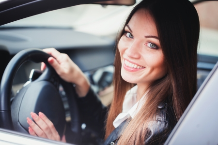 Beautiful young woman driving the car