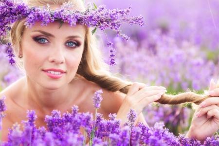 Beautiful blond woman on lavender field Standard-Bild