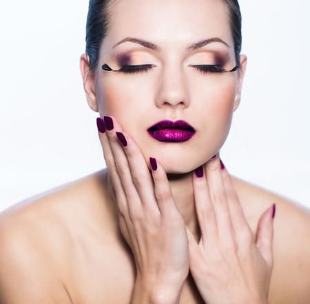 Woman studio portrait with bright makeup