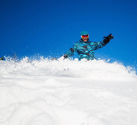 Young man riding on snowboard