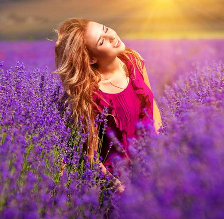 Beautiful girl on the lavender field Banco de Imagens
