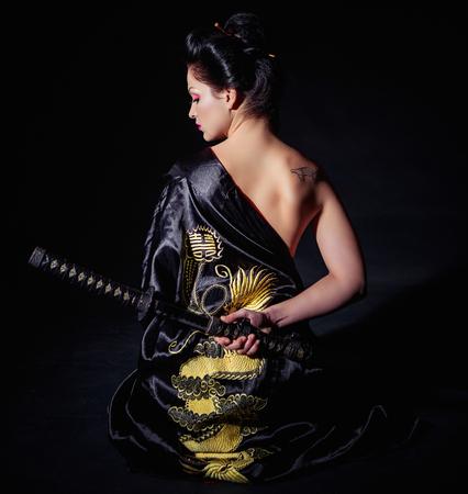 Woman with japan sword katana in hands Banco de Imagens