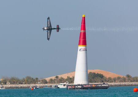 ABU-DHABI, UNITED ARABIAN EMIRATES - FEBRUARY 14 . Racing airplane at the stage of redbull airrace competition on february 14, 2015 in Abu-Dhabi, United Arabian Emirates Editorial