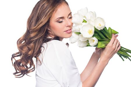 Young beautiful woman studio portrait with tulip flowers Banco de Imagens