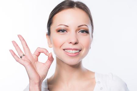 Beautiful young woman with teeth braces Banco de Imagens - 37359282