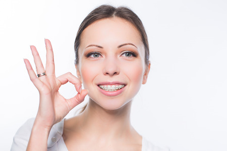 Beautiful young woman with teeth braces Banque d'images