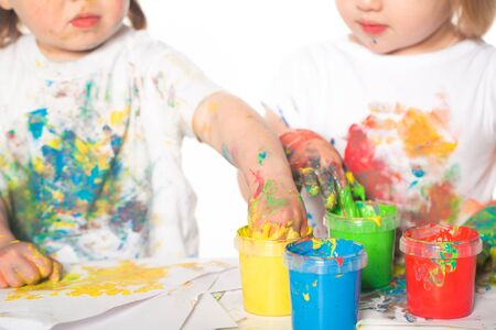 Little boy and girl playing with paints Banco de Imagens - 38371939