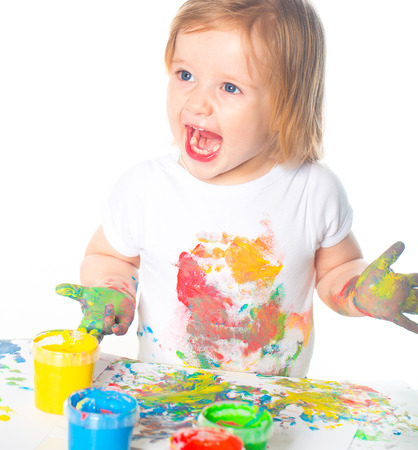 Little girl playing with paints
