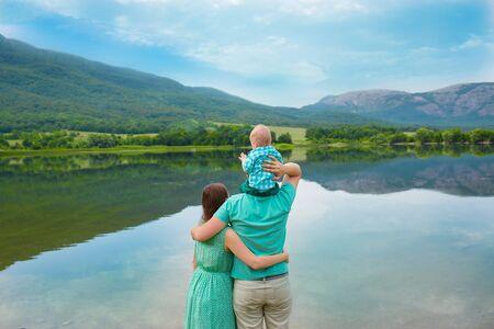 Family resting on the lake Banco de Imagens - 39539138
