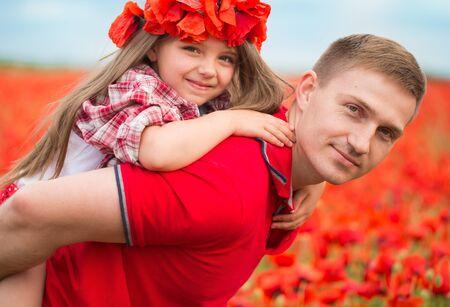 Happy family resting on the poppy field Banco de Imagens