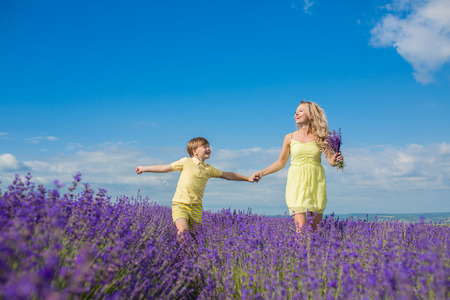 Mother with little son on lavender field