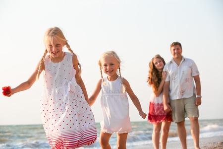 Happy family resting on the summer beach Banco de Imagens