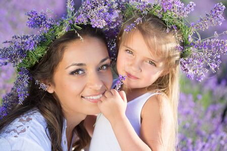 Beautiful happy couple mother and her  cute daughter  in lavender field Banco de Imagens