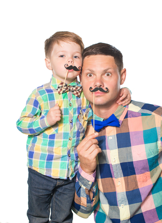 Happy father and son playing with paper mustache isolated on white Stockfoto