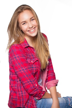 Close up portrait of smiling teen girl showing dental braces. Isolated on white background. Stockfoto
