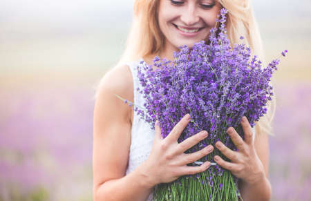 Beautiful girl on the lavender field Stock fotó
