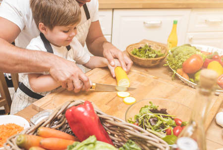 Father is cooking with his son Standard-Bild