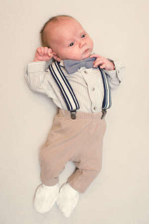 newborn baby dressed like gentleman