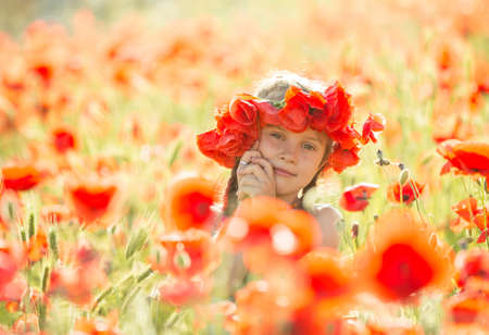 Little girl in a poppies