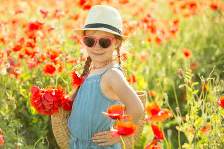 Little girl posing in a poppies