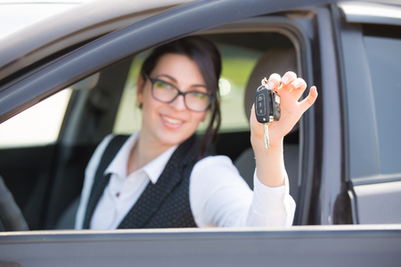 Young business woman portrait in her car Banco de Imagens