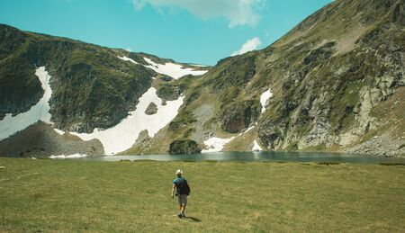 Adventures in the Rila Mountains of Bulgaria. A man traveling alone and enjoy the view of the mountains. Route seven Rila lakes Banco de Imagens