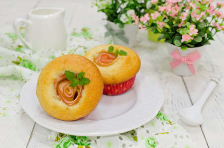 Apple muffins with fresh apples on a wooden background photo
