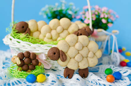 Holiday almond biscuits lamb in a basket on the Easter table. Square photo