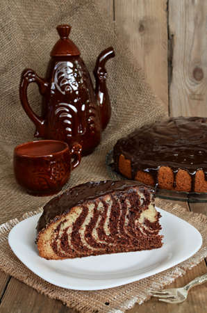 Pie Zebra with chocolate icing on wooden table photo