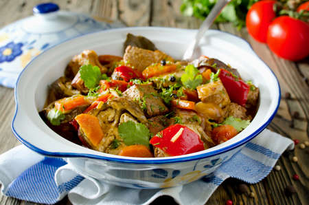 Beef ragout with vegetables. Meat with eggplant, carrots, tomatoes and bell pepper photo