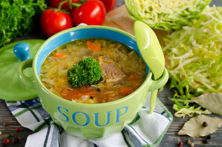 Shchi - traditional russian cabbage soup on a wooden table. Style rustic. Selective focus photo