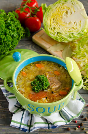 Shchi - traditional russian cabbage soup on a wooden table. Style rustic. Selective focus Stock Photo