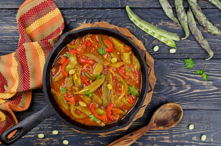 chinese food: Vegetable stew with beans, paprika and spices in tomato sauce