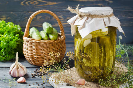Fresh and pickled cucumbers, homemade preserved vegetables