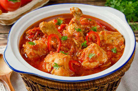 Chakhokhbili - chicken stewed with tomatoes and onions. Georgian national dish Stock Photo