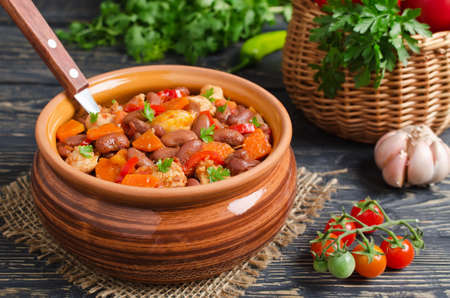meat dish: Vegetable stew with chicken and beans. Rustic style