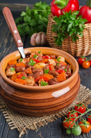 lima beans white beans: Vegetable stew with chicken and beans. Rustic style