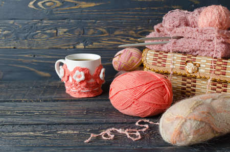 sewing cotton: Pink yarn and craft items on a wooden table