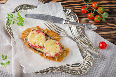 chicken chop: Chicken chop with tomatoes and eggplants with cheese crust
