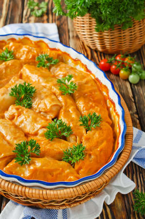 polish chicken: Stuffed cabbage rolls with rice and meat in tomato sauce