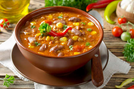 red chili pepper: Mexican dish Chili Con Carne in plate Stock Photo