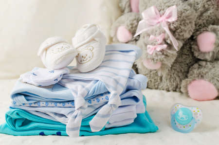 pile of clothes: Baby clothes for newborn. In pastel colors