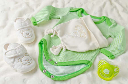 green clothes: Baby clothes for newborn. In pastel colors