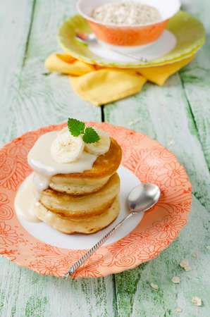 shrove: A stack of pancakes on a wooden table. Shrove Tuesday