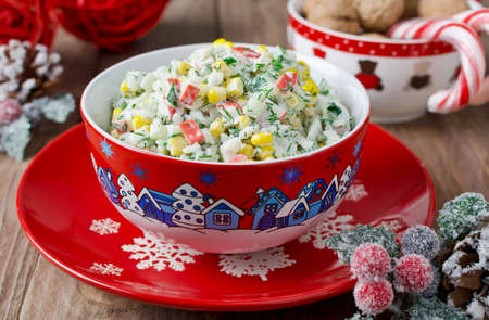 crab: Salad with crab sticks, corn, cucumber, and rice Stock Photo