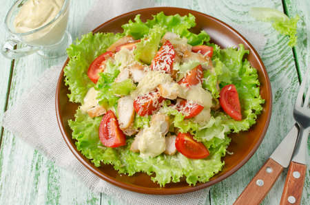chicken salad: Salad with chicken and vegetables, sprinkled with grated cheese Stock Photo