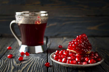 pomegranate: Pomegranate juice and pomegranate on wooden table